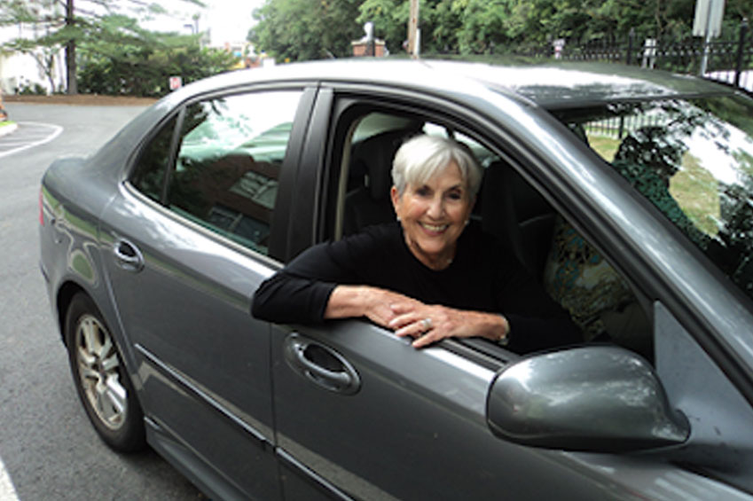 Woman smiling in car.